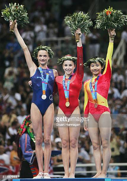 Svetlana Khorkina of Russia Carly Patterson of the United States and Nan Zhang of China celebrate after receiving their medals in the women's...