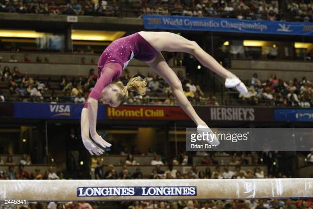 Svetlana Khorkina of Russia competes in the balance beam during the Women's Individual AllAround Final of the 2003 World Gymnastics Championships on...