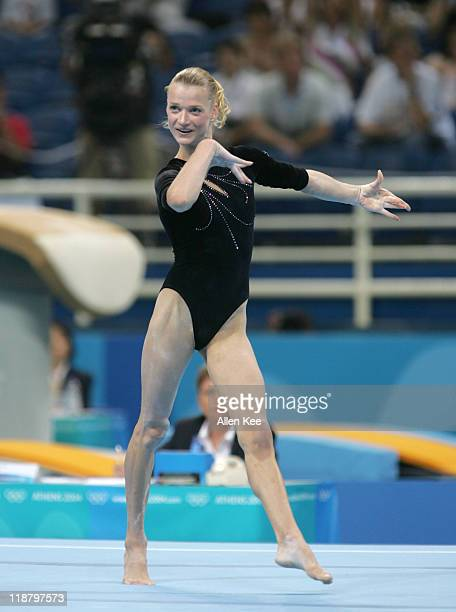 Svetlana Khorkina of Russia in the Women's Individual AllAround in the Olympic Indoor Hall at the Athens 2004 Olympic Games in Athens Greece August...