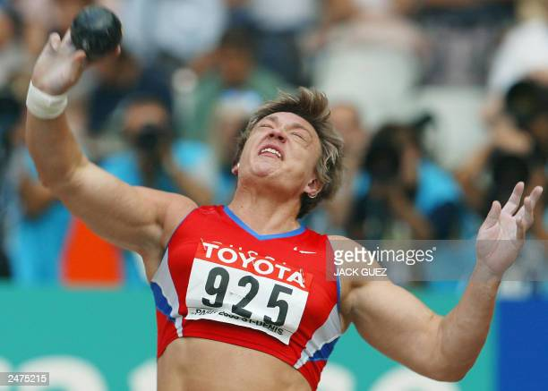 Svetlana Krivelyova of Russia competes in the women's shot put qualifier 27 August 2003 during the 9th Athletics World Championships at the Stade de...
