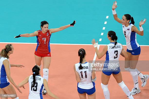 Svetlana Kryuchkova of Russia leads her teammates as they celebrate winning a point during the women's preliminary pool A volleyball match between...