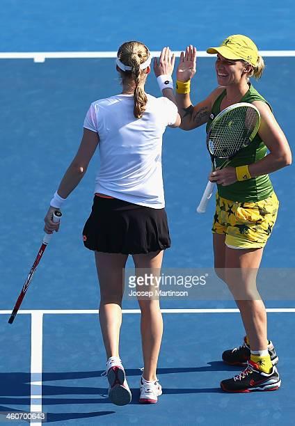 Svetlana Kuznetsova and Ekaterina Makarova of Russia celebrate after winning a point against Raquel KopsJones and Abigail Spears of the United States...