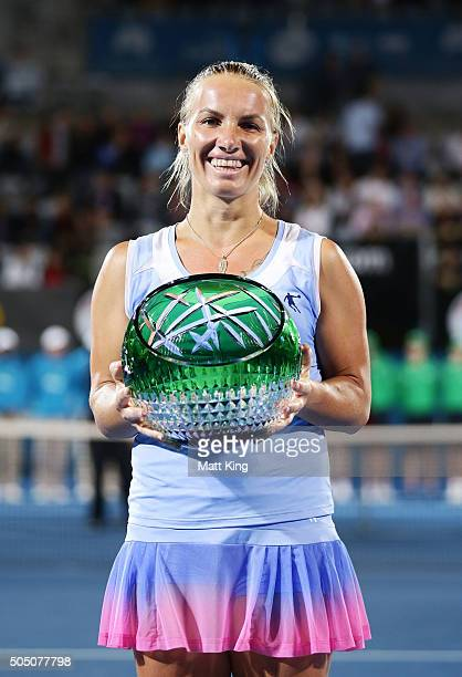 Svetlana Kuznetsova of Russia celebrates and holds aloft the winners trophy after winning the final match against Monica Puig of Puerto Rico day six...