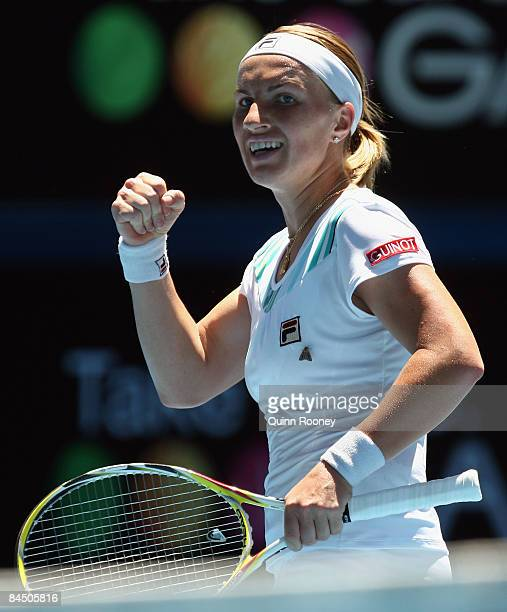 Svetlana Kuznetsova of Russia celebrates winning a point in her quarterfinal match against Serena Williams of the United States of America during day...
