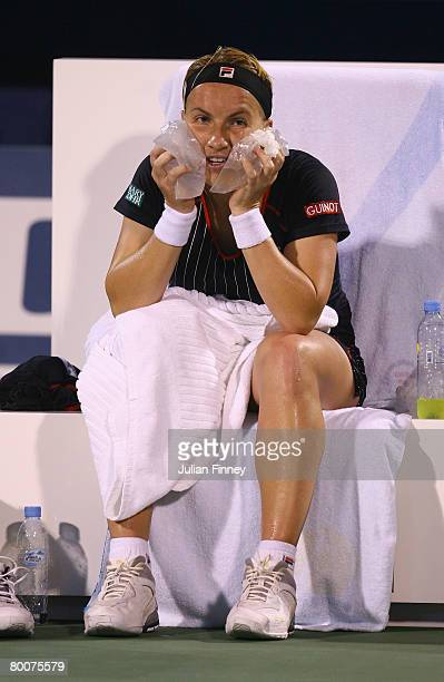 Svetlana Kuznetsova of Russia cools down with some ice in her match against Elena Dementieva of Russia in the final during day six of the WTA...