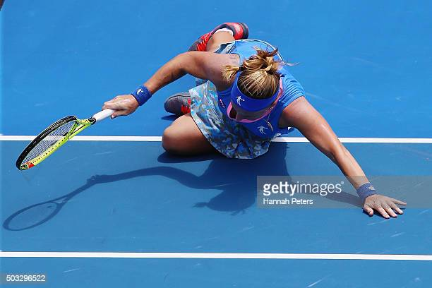 Svetlana Kuznetsova of Russia falls over during her first round match against Mona Barthel of Germany during day one of the 2016 ASB Classic at the...