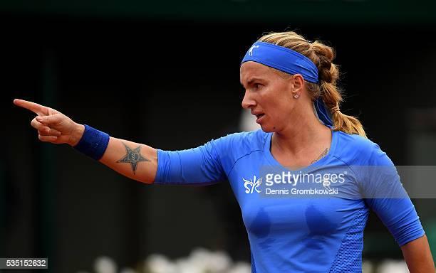 Svetlana Kuznetsova of Russia gestures during the Ladies Singles fourth round match against Garbine Muguruza of Spain on day eight of the 2016 French...