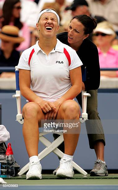Svetlana Kuznetsova of Russia gets her back massaged by WTA trainer Amber Donaldson during her match against Gisela Dulko of Argentina in the third...