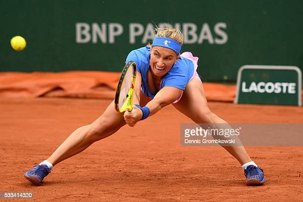 Svetlana Kuznetsova of Russia hits a backhand during the Ladie's Singles first round match against Yaroslava Shvedova of Kazakhstan on day one of the...