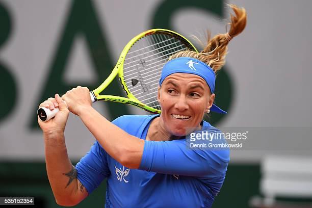 Svetlana Kuznetsova of Russia hits a backhand during the Ladies Singles fourth round match against Garbine Muguruza of Spain on day eight of the 2016...