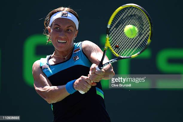 Svetlana Kuznetsova of Russia hits a backhand return against Shuai Peng of China during the Sony Ericsson Open at Crandon Park Tennis Center on March...