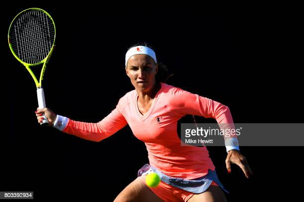 Svetlana Kuznetsova of Russia hits a forehand during the ladies singles quarter final match against Karolína Pliskova of Russia on day five of the...