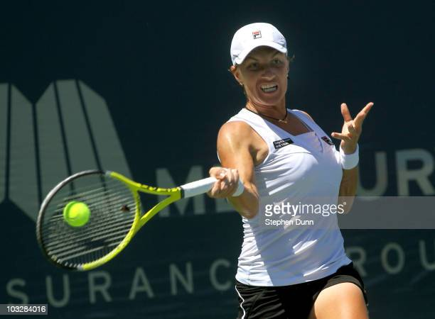Svetlana Kuznetsova of Russia hits a forehand to Flavia Pennetta of Italy during their semifinal match in the Mercury Insurance Open at La Costa...