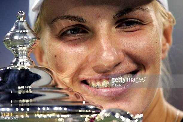 Svetlana Kuznetsova of Russia holds the trophy after defeating Elena Dementieva of Russia in the women's final during the US Open September 11, 2004...