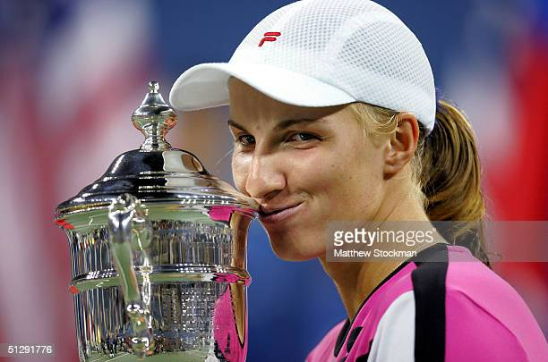 Svetlana Kuznetsova of Russia holds the trophy on her head after defeating Elena Dementieva of Russia in the women's final during the US Open...