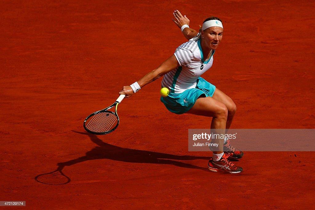 Svetlana Kuznetsova of Russia in action against Garbine Muguruza of Spain during day three of the Mutua Madrid Open tennis tournament at the Caja Magica on May 4, 2015 in Madrid, Spain.