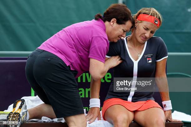 Svetlana Kuznetsova of Russia is worked on by a trainer while playing against Marion Bartoli of France during day seven of the 2010 Sony Ericsson...