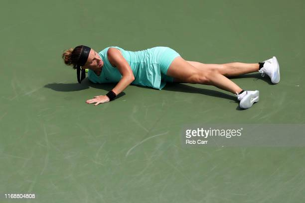 Svetlana Kuznetsova of Russia lays on the ground after returning a shot to Madison Keys of the United States during the Women's Final of the Western...