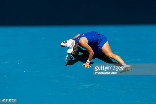 Svetlana Kuznetsova of Russia loses her balance in her fourth round match against Caroline Wozniacki of Denmark during day eight of the 2013...