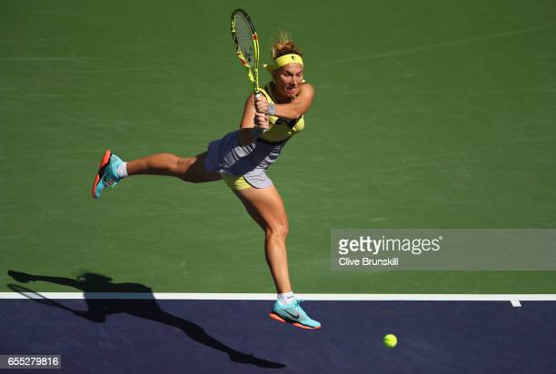 Svetlana Kuznetsova of Russia plays a backhand against Elena Vesnina of Russia in the womens final during day fourteen of the BNP Paribas Open at...