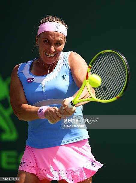 Svetlana Kuznetsova of Russia plays a backhand against Timea Bacsinszky of Switzerland during their semi final match during the Miami Open Presented...