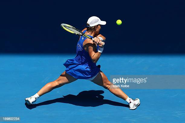 Svetlana Kuznetsova of Russia plays a backhand in her fourth round match against Caroline Wozniacki of Denmark during day eight of the 2013...