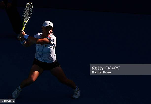 Svetlana Kuznetsova of Russia plays a backhand in her match against Nicole Vaidisova of Czech Republic during day five of the Medibank International...