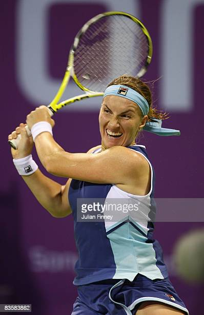 Svetlana Kuznetsova of Russia plays a backhand in her match against Jelena Jankovic of Serbia during the Sony Ericsson Championships at the Khalifa...