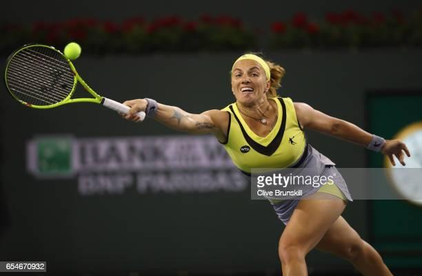 Svetlana Kuznetsova of Russia plays a forehand against Karolina Pliskova of the Czech Republic in their semi final match during day twelve of the BNP...