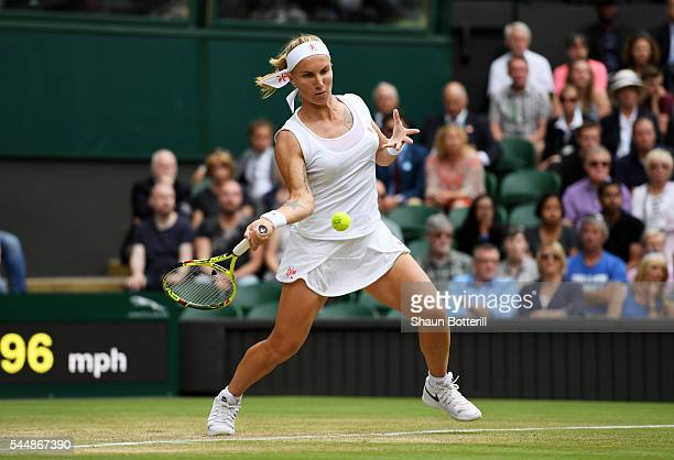 Svetlana Kuznetsova of Russia plays a forehand during the Ladies Singles fourth round match against Serena Williams of The United States on day seven...