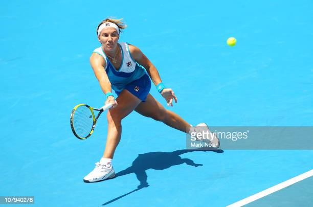 Svetlana Kuznetsova of Russia plays a forehand in her first round match against Jelena Dokic of Australia on day one of the 2011 Medibank...