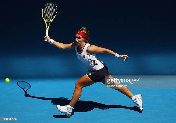 Svetlana Kuznetsova of Russia plays a forehand in her fourth round match against Nadia Petrova of Russia during day seven of the 2010 Australian Open...
