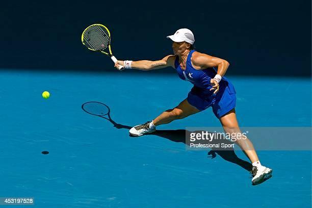 Svetlana Kuznetsova of Russia plays an awkward forehand return in her fourth round match against Caroline Wozniacki of Denmark during day eight of...