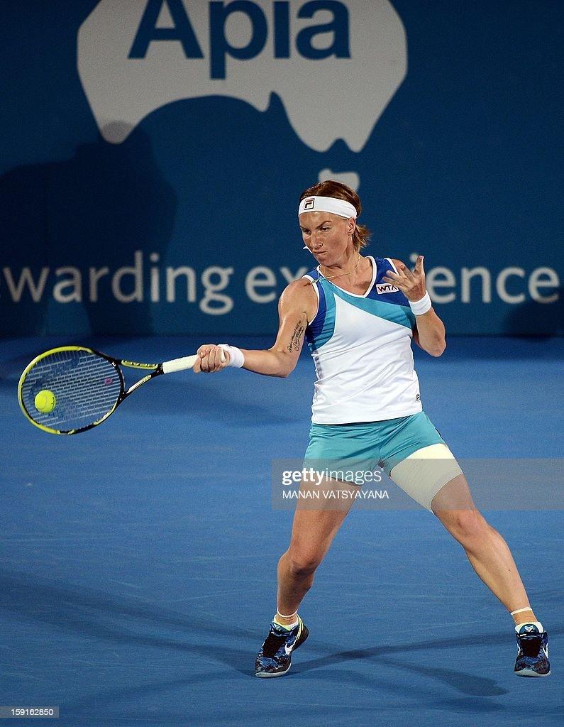 Svetlana Kuznetsova of Russia returns a shot against Angelique Kerber of Germany during their quarter-final match of the Sydney International tennis tournament on January 9, 2013.