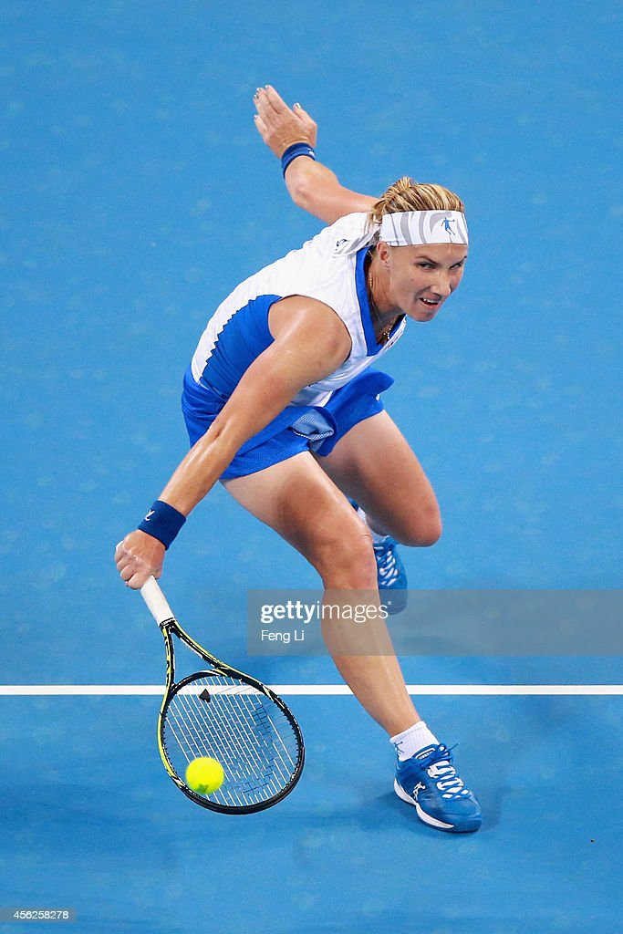 Svetlana Kuznetsova of Russia returns a shot against Daniela Hantuchova of Slovakia during day two of the China Open at the China National Tennis Center on September 28, 2014 in Beijing, China.