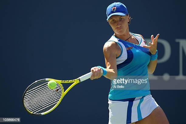 Svetlana Kuznetsova of Russia returns a shot against Dominika Cibulkova of Slovakia during her women's singles match on day eight of the 2010 U.S....
