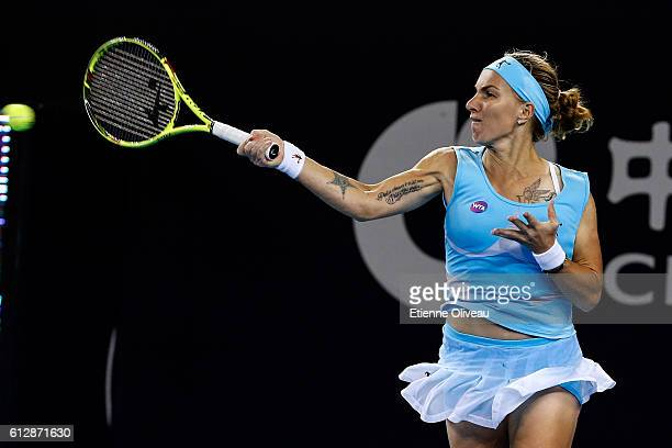 Svetlana Kuznetsova of Russia returns a shot against Madison Keys of the United States during her Women's singles third round match on day five of...