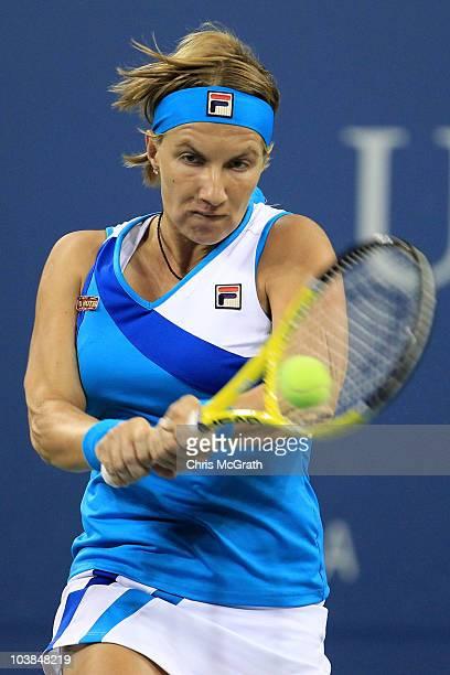 Svetlana Kuznetsova of Russia returns a shot against Maria Kirilenko of Russia during her women's singles match on day six of the 2010 U.S. Open at...