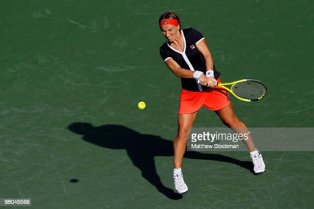 Svetlana Kuznetsova of Russia returns a shot against Shuai Peng of China during day three of the 2010 Sony Ericsson Open at Crandon Park Tennis...
