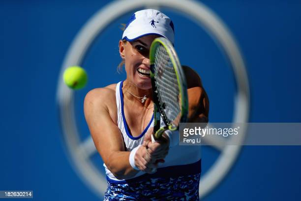 Svetlana Kuznetsova of Russia returns a shot during her women's singles match against Andrea Petkovic of Germany on day five of the 2013 China Open...