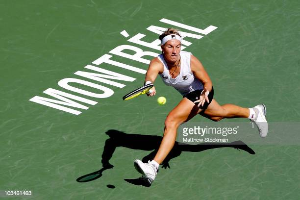 Svetlana Kuznetsova of Russia returns a shot to Agnieszka Radwanska of Poland during the Rogers Cup at Stade Uniprix on August 19 2010 in Montreal...
