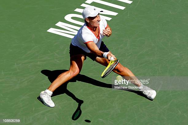 Svetlana Kuznetsova of Russia returns a shot to Jie Zheng of China returns a shot to during the Rogers Cup at Stade Uniprix on August 20 2010 in...