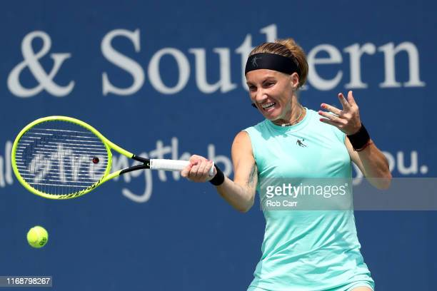 Svetlana Kuznetsova of Russia returns a shot to Madison Keys of the United States during the Women's Final of the Western and Southern Open at...
