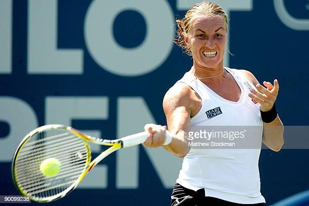 Svetlana Kuznetsova of Russia returns a shot to Yanina Wickmayer of Belgium during the Pilot Pen Tennis tournament at the Connecticut Tennis Center...