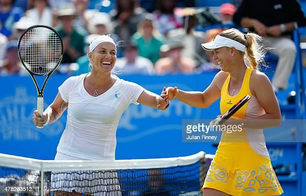 Svetlana Kuznetsova of Russia shares a joke at net with Caroline Wozniacki of Denmark during the Aegon International day four at Devonshire Park on...