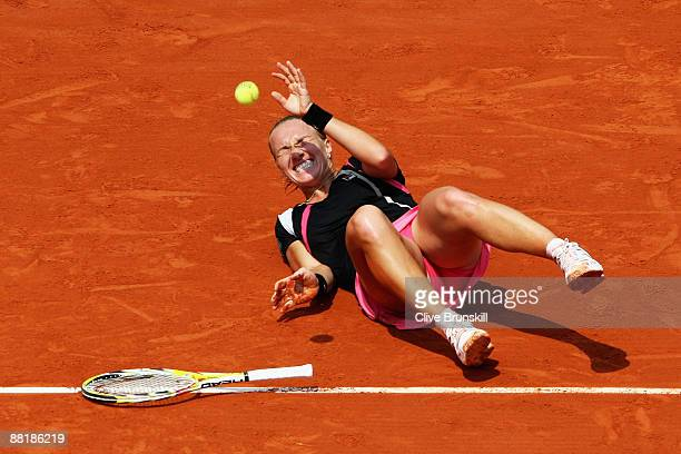 Svetlana Kuznetsova of Russia slips and falls whilst playing a shot during the Women's Singles Quarter Final match against Serena Williams of USA on...