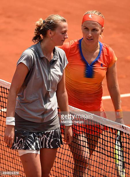 Svetlana Kuznetsova of Russia speaks with Petra Kvitova of Czech Republic at the net following her victory in their women's singles match on day...