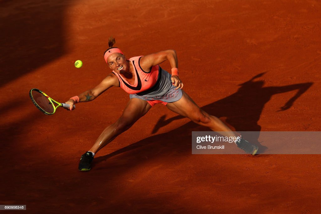 Svetlana Kuznetsova of Russia stretches to play a forehand during the ladies singles second round match against Oceane Dodin of France on day four of the 2017 French Open at Roland Garros on May 31, 2017 in Paris, France.