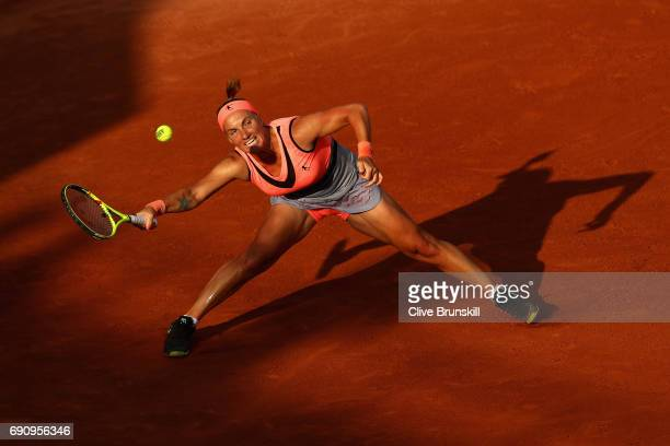 Svetlana Kuznetsova of Russia stretches to play a forehand during the ladies singles second round match against Oceane Dodin of France on day four of...