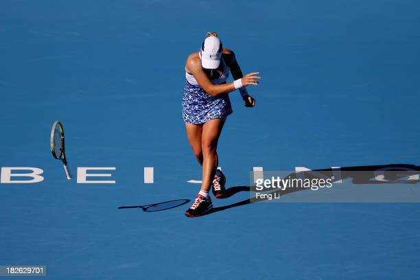 Svetlana Kuznetsova of Russia throw away the racket during her women's singles match against Andrea Petkovic of Germany on day five of the 2013 China...